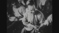 Prisoners sitting and eating in prison camp Stock Footage