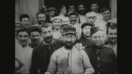 Military soldier and prisoners standing in prison camp and smiling Stock Footage