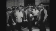 Prisoners holding bowls and standing in prison camp Stock Footage