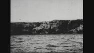 View of boats in sea and rock formation from u-boat Stock Footage