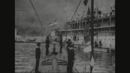 Navy soldiers mooring u-boat at harbour Stock Footage