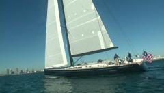Sailing boat slowly navigating close to the coast in Miami  - stock footage