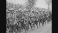Military troops marching on road Stock Footage