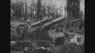 Military soldiers firing cannon Stock Footage