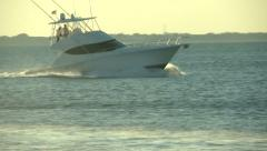 Fishing boat navigating fast at the sunset  - stock footage