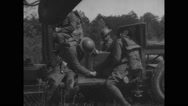 Military soldiers adjusting sound locator machine in military land vehicle Stock Footage