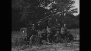 Military soldiers adjusting and testing 3-4 inch anti-aircraft gun Stock Footage