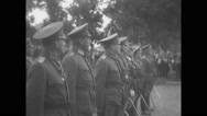 Douglas MacArthur standing with other military officials Stock Footage