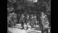 Douglas MacArthur walking at memorial service in cemetery Stock Footage
