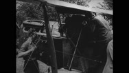 Mail being unloaded from biplane Stock Footage