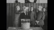 Vice President Marshall and others drawing draft numbers from glass jar Stock Footage