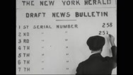 Officer writing draft number on bulletin board Stock Footage