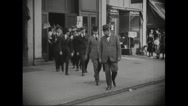 Draftees coming out of building Stock Footage
