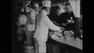 Chefs serving food to draftees Stock Footage
