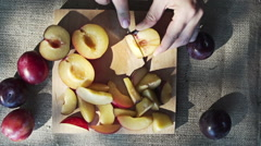 Slicing Plum, Slow Motion Stock Footage