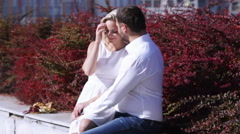 Couple sitting and tenderness on city background Stock Footage
