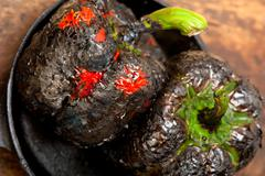 Charcol scorched fresh bell peppers Stock Photos