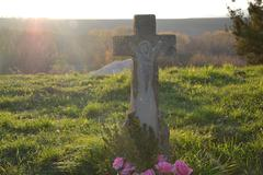 Old grave at sunset in the cemetery, graveyard Kuvituskuvat