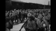 Italian troops marching besides moving train Stock Footage