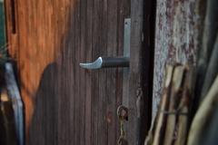 Handles of wooden door in an old hovel - stock photo