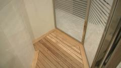 Shower with wooden floor on a yacht  - stock footage
