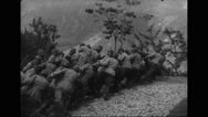 Military soldiers moving artillery to the front lines in the Alps Stock Footage