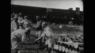 Soldiers loading shells on train Stock Footage