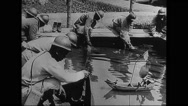 Military soldiers washing their feet and clothes Stock Footage