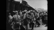 Troops getting inside train Stock Footage