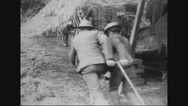 Military soldiers carrying howitzer shells Stock Footage