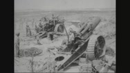 Military soldiers firing howitzer Stock Footage