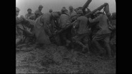 Military soldiers pushing a horse cart out of bog Stock Footage