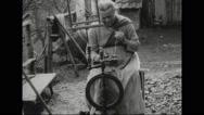 Woman spinning thread on wheel Stock Footage