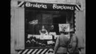 Two French soldiers window shopping outside a shop Stock Footage