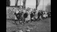 Girls and nuns walking with wreath Stock Footage