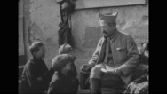 French soldier talking with French boys Stock Footage