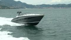 Luxury yacht navigating close to the coast  - stock footage