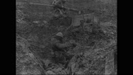 French military soldier preparing to camouflage in no man's land Stock Footage
