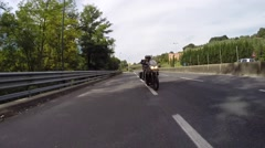 Motorbike riding towards the camera on a highway in Italy - stock footage