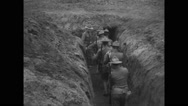 Military soldiers walking into trench Stock Footage