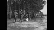 Military soldiers practising with flag Stock Footage