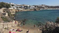 Mykonos Greece sandy beach along coastal cliff 4K 154 Stock Footage