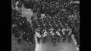 Military soldiers marching in funeral procession Stock Footage