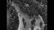 Military soldiers marching and flag draped coffin being carried on horse cart Stock Footage
