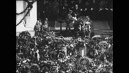 Military officer laying a wreath on coffin at the funeral Stock Footage