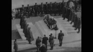 Military soldiers gathered around tomb at the funeral Stock Footage