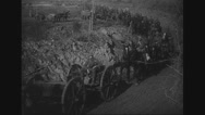 Military soldiers walking and riding horses on dirt track Stock Footage