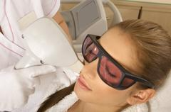 Laser hair removal in professional studio. Stock Photos