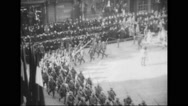Crowd watching French allied troops marching at parade Stock Footage