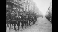 French soldiers sitting on horse carts and riding horses at parade Stock Footage